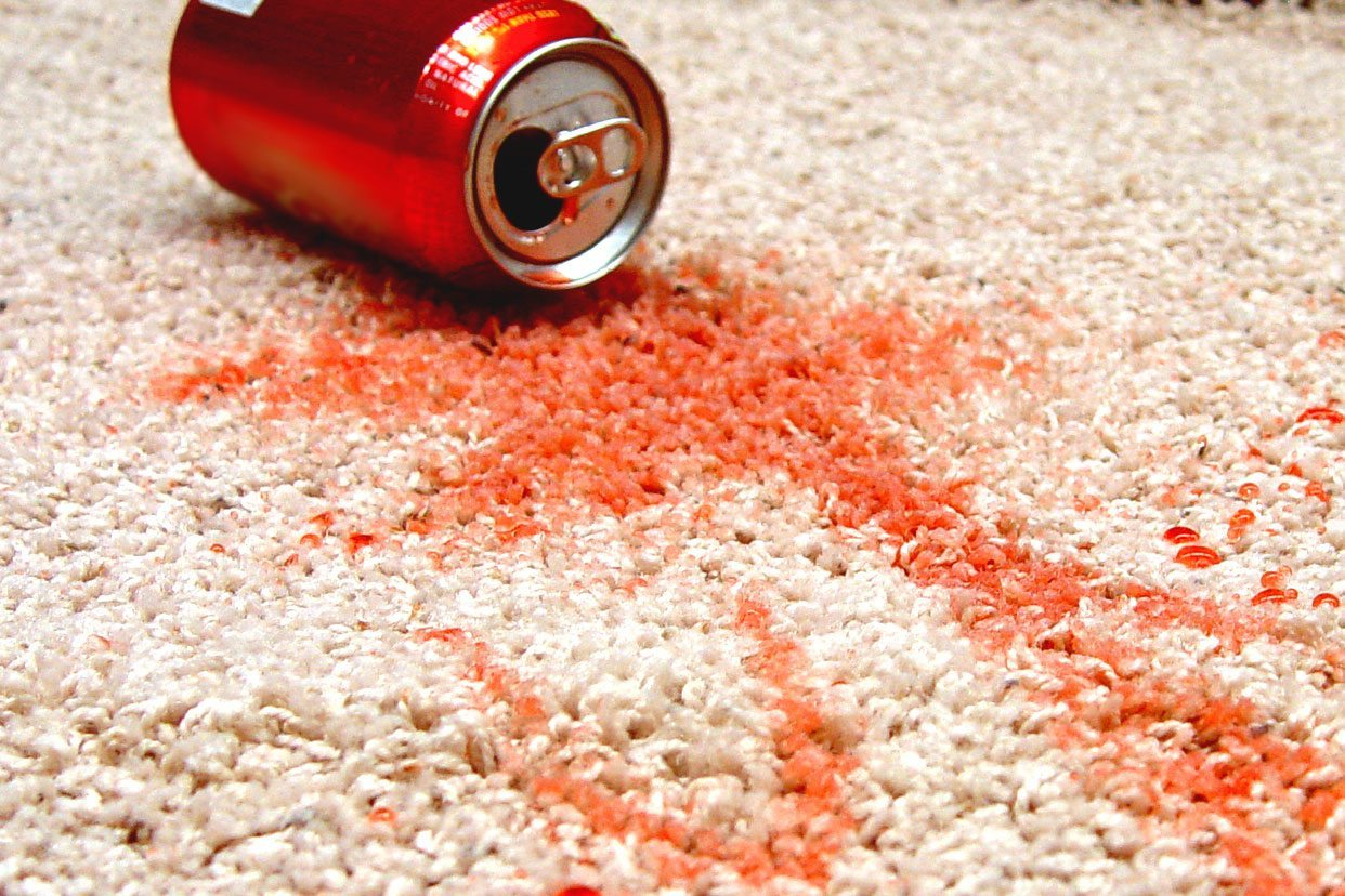 red soda spilled on the carpet